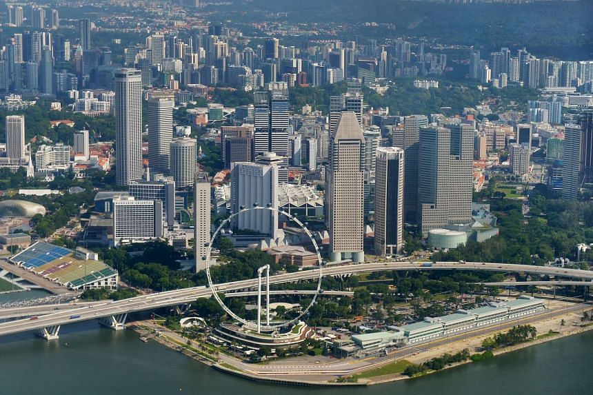 The Singapore Central Business District, with the Singapore Flyer in the foreground.
