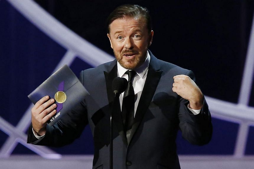 Ricky Gervais presents an award during the 66th Primetime Emmy Awards in Los Angeles, California.