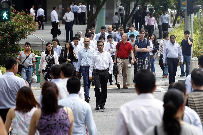 Office workers at Raffles Quay on Feb 18, 2015.