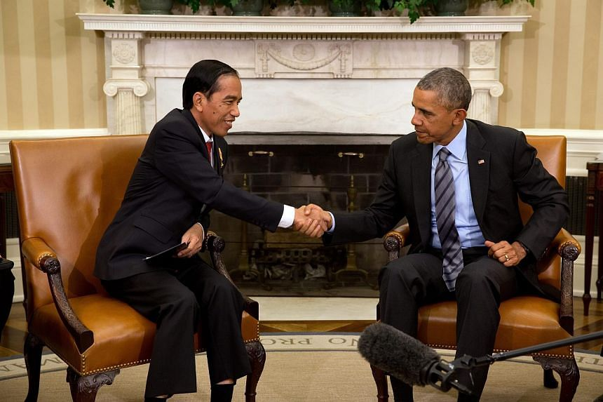 US President Barack Obama (right) meeting with Indonesian President Joko Widodo at the White House on Oct 26, 2015.