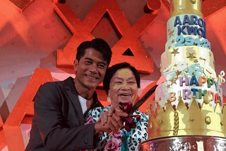 Aaron Kwok and his mother at the party.