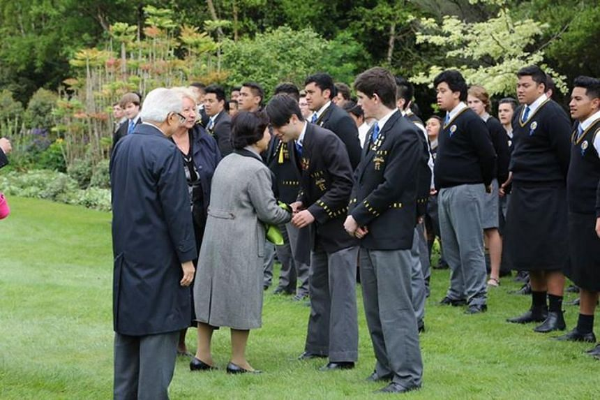 """President and Mrs Tan received the Maori """"Hongi"""" greeting from students at the welcome ceremony. The greeting comprises pressing of the nose and forehead."""