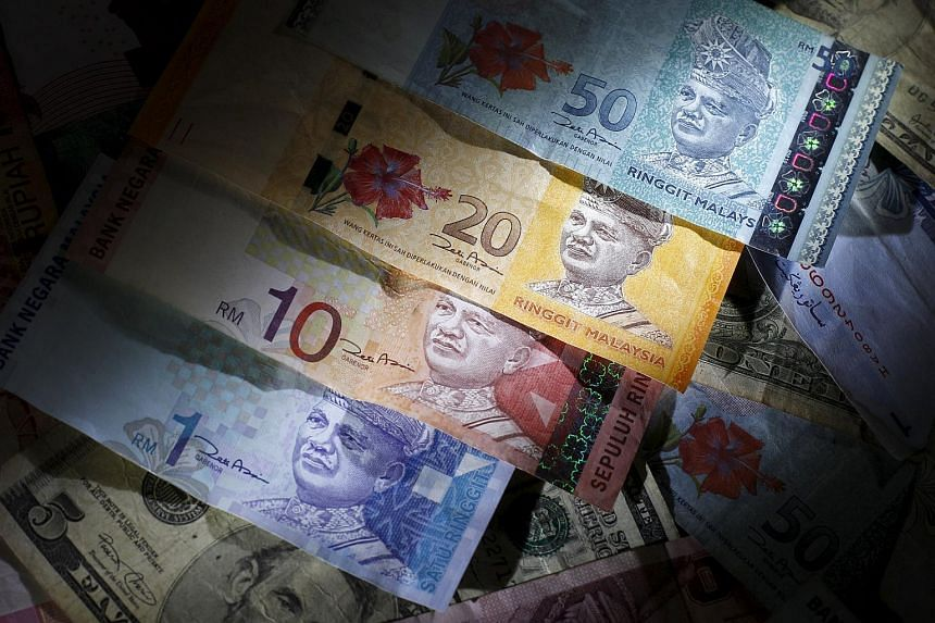 Malaysian ringgit notes are seen among other currency notes in this photo illustration.