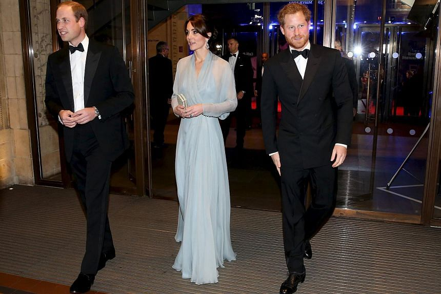 Prince William, Duke of Cambridge (left), Catherine, Duchess of Cambridge (center) and Prince Harry (right) attend The Cinema and Television Benevolent Fund's Royal Film Performance 2015 of the new James Bond 007 film Spectre at Royal Albert Hall on