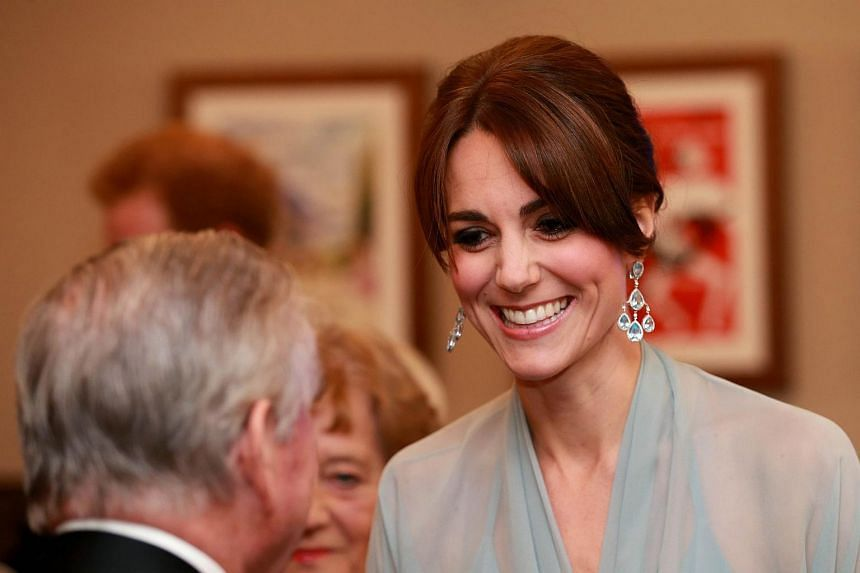 Britain's Catherine, Duchess of Cambridge meets charity representatives as she attends the world premiere of the new James Bond film Spectre at the Royal Albert Hall in London on Oct 26, 2015.
