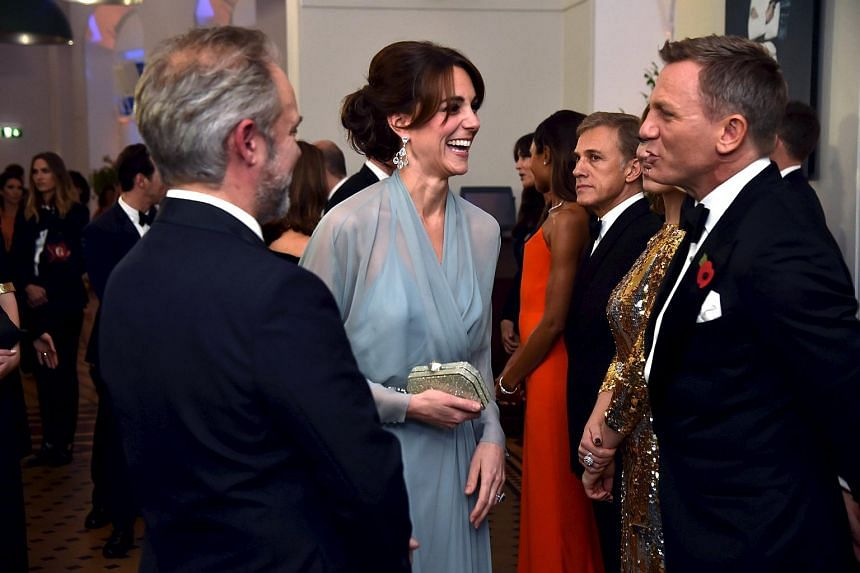 Catherine Duchess of Cambridge (center) speaks to cast member Daniel Craig (right) before the world premiere of the new James Bond 007 film Spectre at the Royal Albert Hall in London, Britain, on Oct 26, 2015.