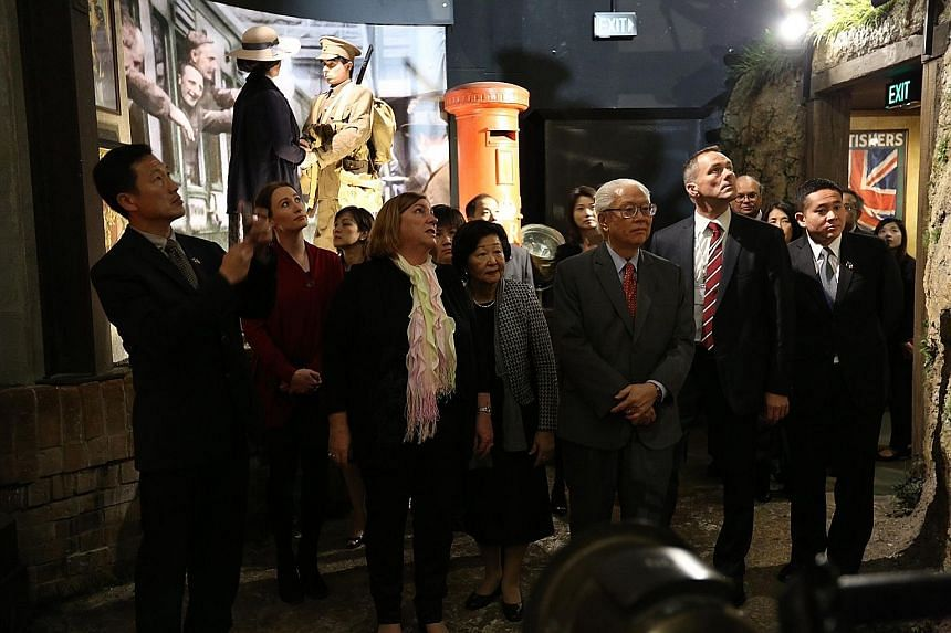 President Tony Tan and his wife Mary taking a tour of the Great War Exhibition at the Dominion Museum in Wellington yesterday. On the far left is Acting Minister for Education (Higher Education and Skills) Ong Ye Kung.