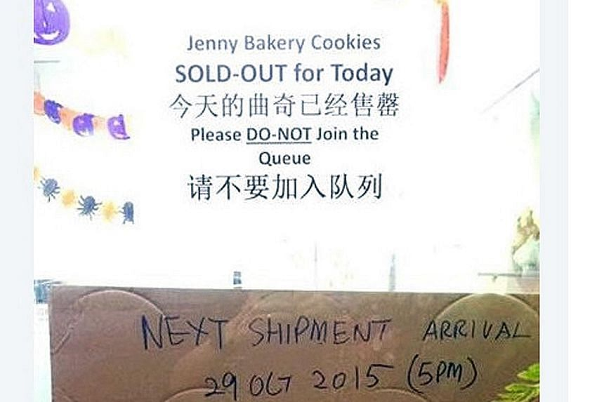 Jenny Bakery pasted a sign on its shopfront to say that its next shipment will only be of the 4 Mix Butter Cookies.