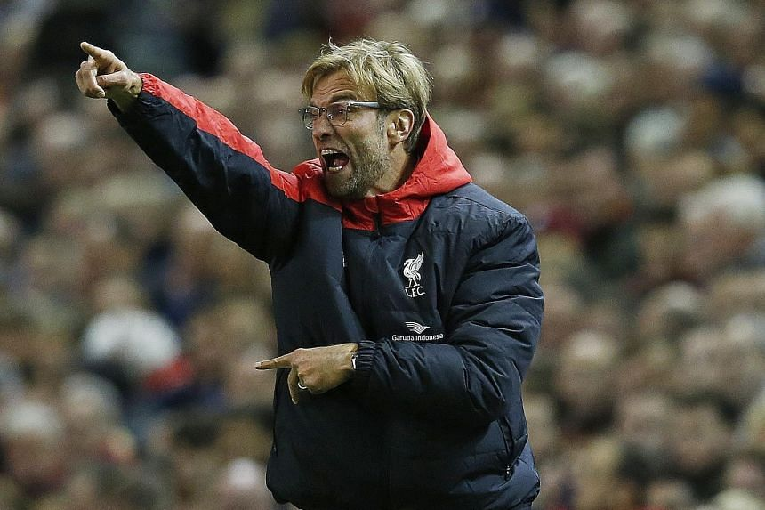 "Juergen Klopp shows his delight as Liverpool score the opening goal of the Premier League match against Southampton on Sunday. He was disappointed with the eventual 1-1 draw, but said: ""We had our moments."""