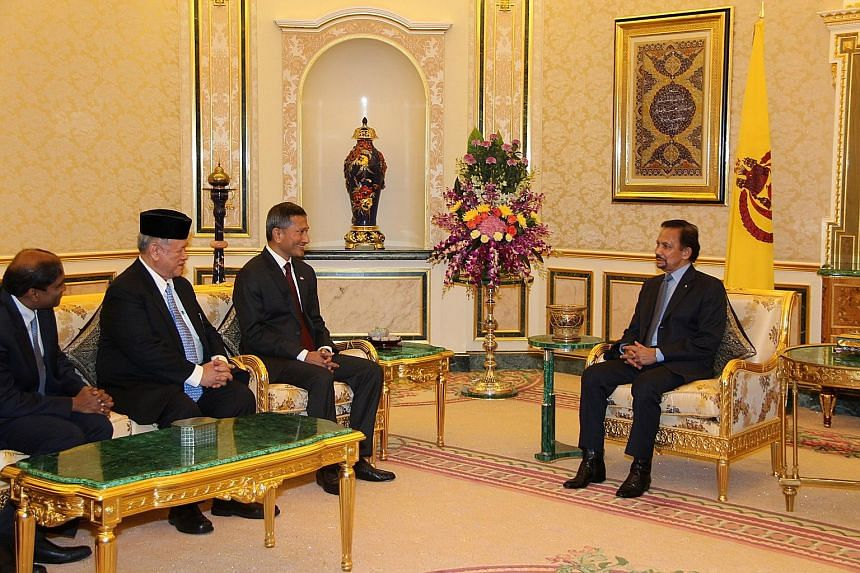 Foreign Minister Vivian Balakrishnan (third from left) having an audience with Brunei's Sultan Haji Hassanal Bolkiah (right) yesterday during his first introductory visit.