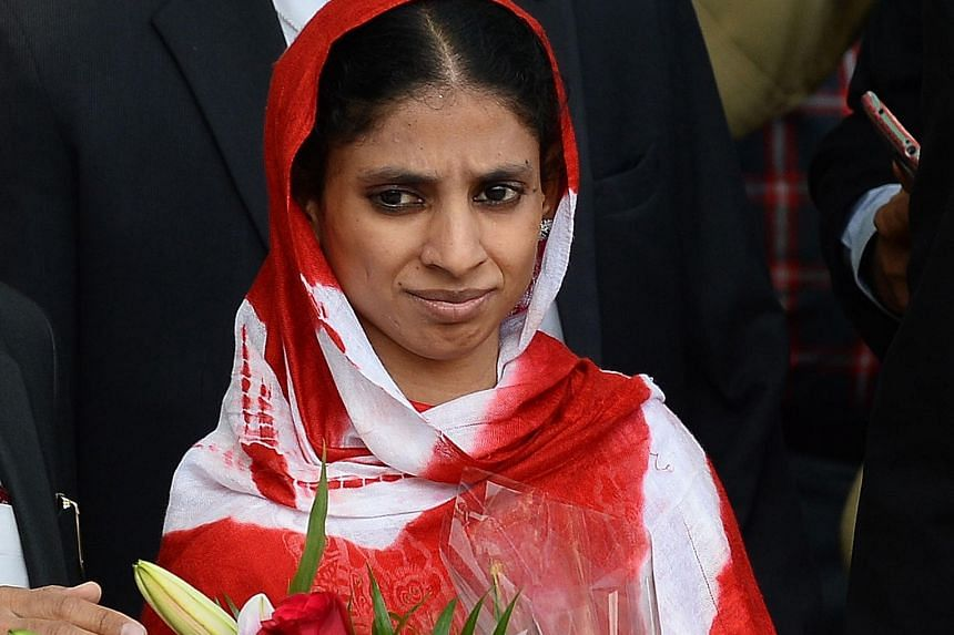 Ms Geeta at the airport yesterday after arriving in New Delhi from Karachi. She strayed into Pakistan more than a decade ago as a child and was unable to identify herself or say where she came from.