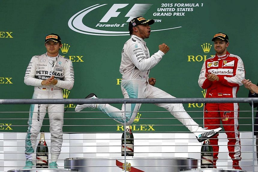 British driver Lewis Hamilton celebrating after sealing his third world  championship with victory in the United 43d56ede5571