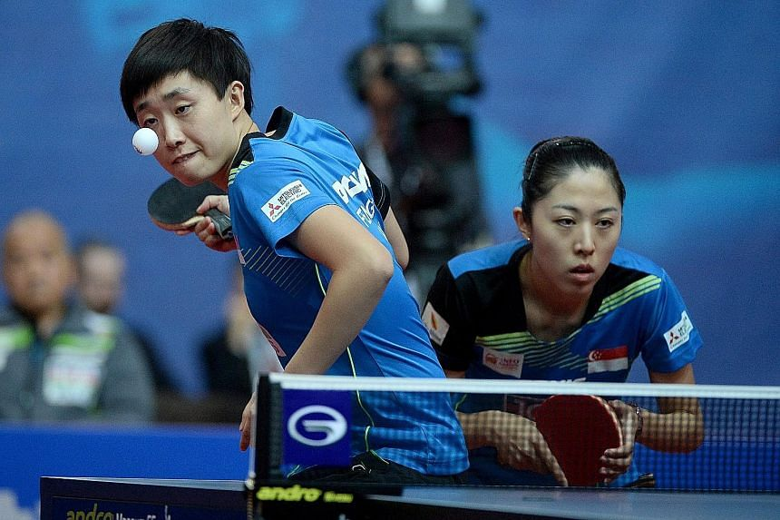 Feng Tianwei (left) and Yu Mengyu lost badly to China's Ding Ning and Zhu Yuling in their ITTF Polish Open women's doubles final after a disagreement between Yu and head coach Jing Junhong.
