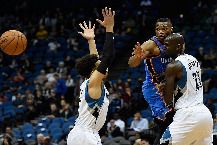 Russell Westbrook (in blue) gets the better of Tyus Jones (left) and Kevin Garnett of the Minnesota Timberwolves in a pre-season game on Oct 7. Westbrook played a pivotal role for the Thunder last season.