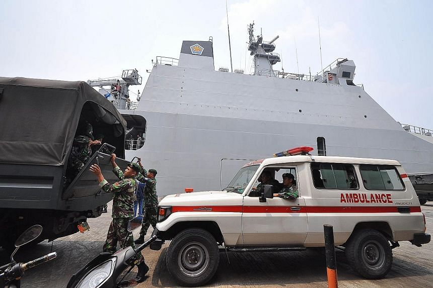 Indonesian soldiers arriving at the Trisakti port in Banjarmasin, South Kalimantan, yesterday, ahead of haze-relief operations. The number of people who have been treated for haze-related illness across Indonesia has breached the half-million mark; 1