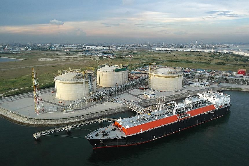 Singapore's first LNG terminal (left) on Jurong Island. Singapore LNG Corporation's former chief executive Neil McGregor, who oversaw the building of the terminal, was a recipient of the Singapore Energy Award.
