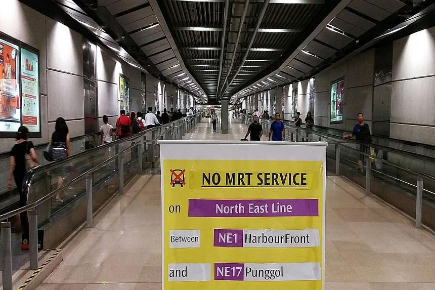 The scene at Serangoon MRT station yesterday morning, when the NEL was down for nearly two hours. The power fault was caused by a new train tugging onto the overhead power system and snapping a wire during tests.