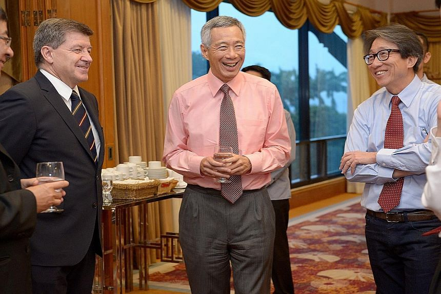 Prime Minister Lee Hsien Loong (centre) with International Labour Organisation director-general Guy Ryder (left) and Manpower Minister Lim Swee Say at the National Delegates Conference opening dinner, held at Orchid Country Club, last night.