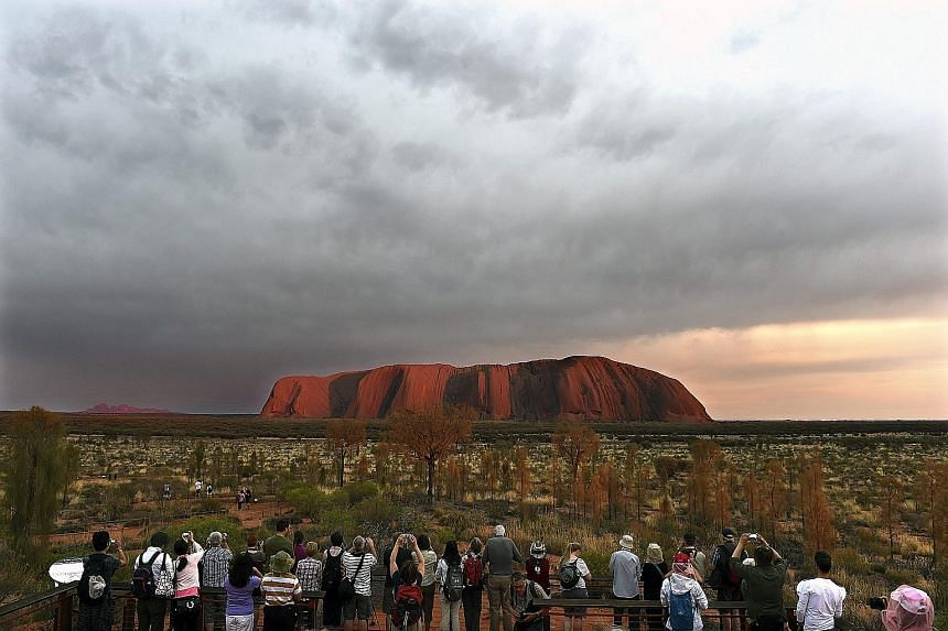 About 300,000 visitors a year visit Uluru, also known as Ayers Rock, in the Northern Territory, Australia, but living standards have changed little for the Anangu people, the area's original inhabitants, since its return to them.