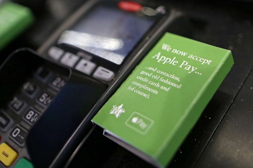 A sign for the launch of the Apple Pay system, by Apple Inc. is seen on the side of a payment device at a Pret A Manger Ltd store in London, U.K., on Jul 14, 2015.