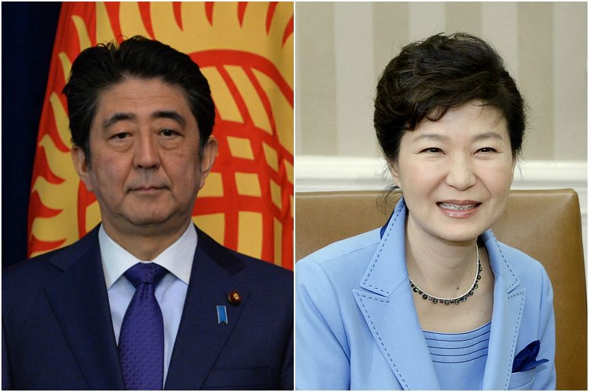 A summit between Japanese Prime Minister Shinzo Abe (left) and South Korean President Park Geun Hye has yet to be set.