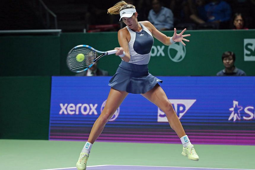 Garbine Muguruza in action against Lucie Safarova during the first match of the WTA Finals White Group.