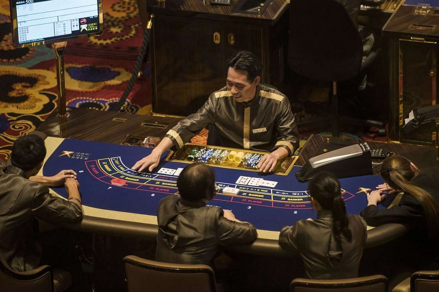 Employees at gaming tables at Studio City casino resort, ahead of its grand opening, on Oct 26, 2015.