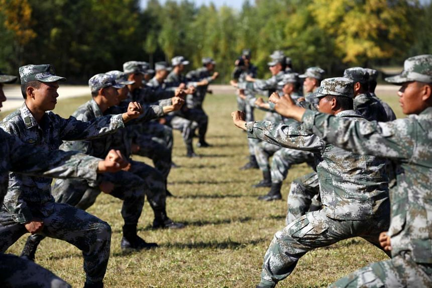 Chinese People's Liberation Army (PLA) soldiers training at their barracks in Heihe, in north-east China's Heilongjiang province, on Sept 16, 2015.