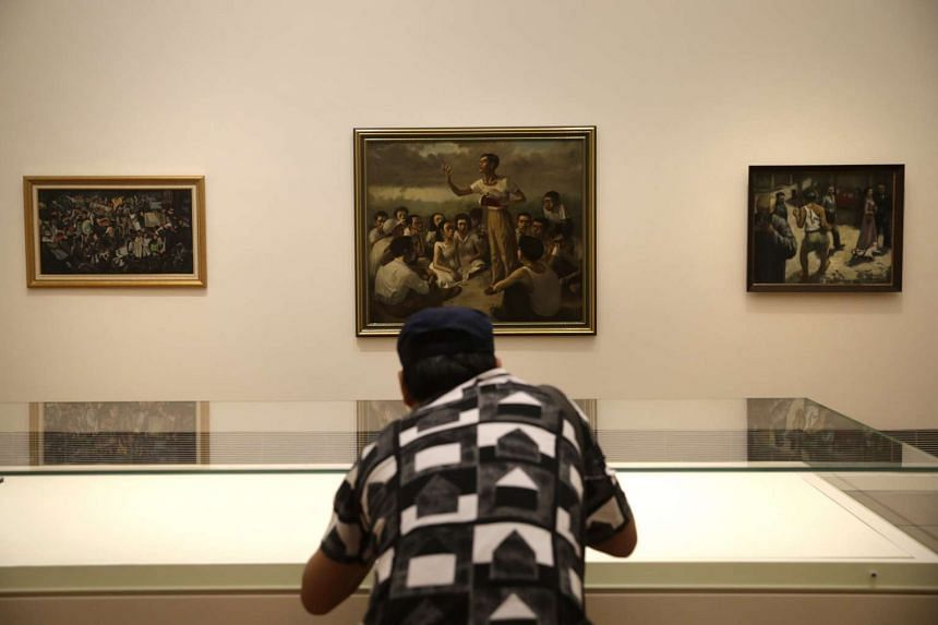A member of the media taking pictures of artwork in the UOB Southeast Asia Gallery 6, one of two permanent galleries in the National Gallery Singapore on Oct 15, 2015.