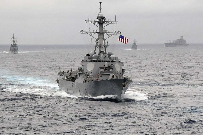 China has criticised the US after the guided missile destroyer USS Lassen (pictured) sailed near several artificial reefs built by Beijing in the South China Sea.