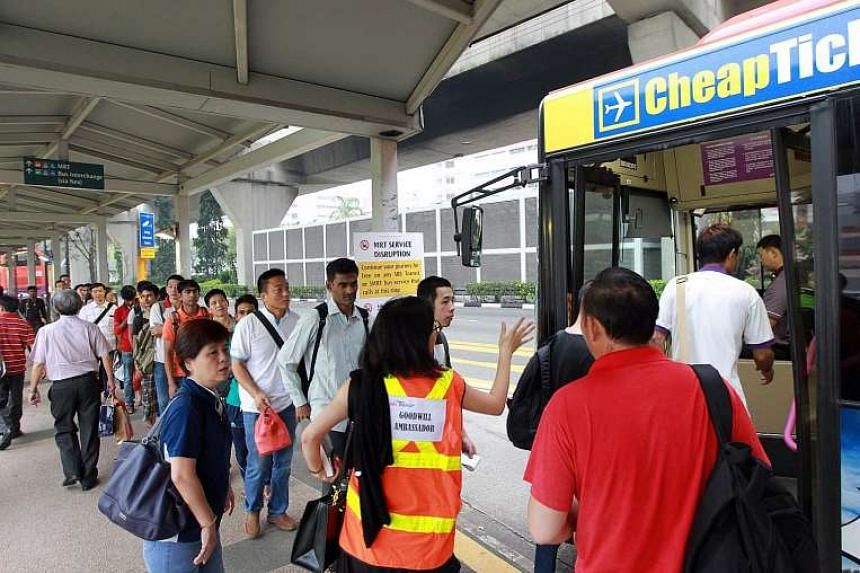 Commuters taking the bus outside Serangoon MRT station yesterday morning after NEL train services broke down owing to a power fault, affecting some 41,000 people during the morning rush hour.