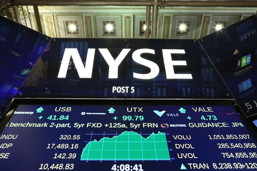 A sign displaying stock quotes near the floor of the New York Stock Exchange on Oct 22, 2015.
