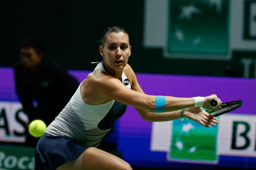 Flavia Pennetta of Italy hitting a return to Agnieszka Radswanka of Poland during their WTA Finals match at the Singapore Indoor Stadium on Oct 27, 2015.