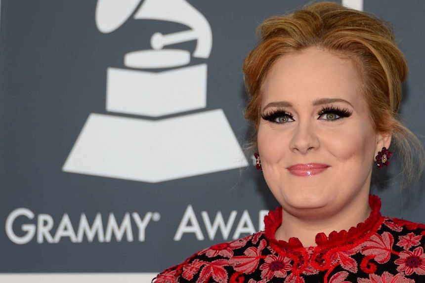 Adele arrives on the red carpet for the 55th Grammy Awards in Los Angeles on Feb 10 this year.