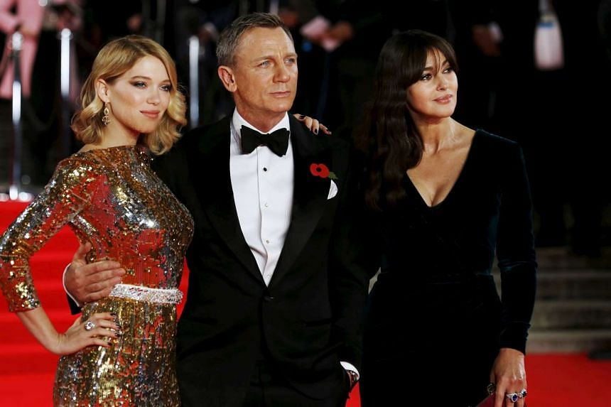 """Lea Seydoux, Daniel Craig and Monica Bellucci (left to right) pose for photographers as they attend the world premiere of Spectre""""."""
