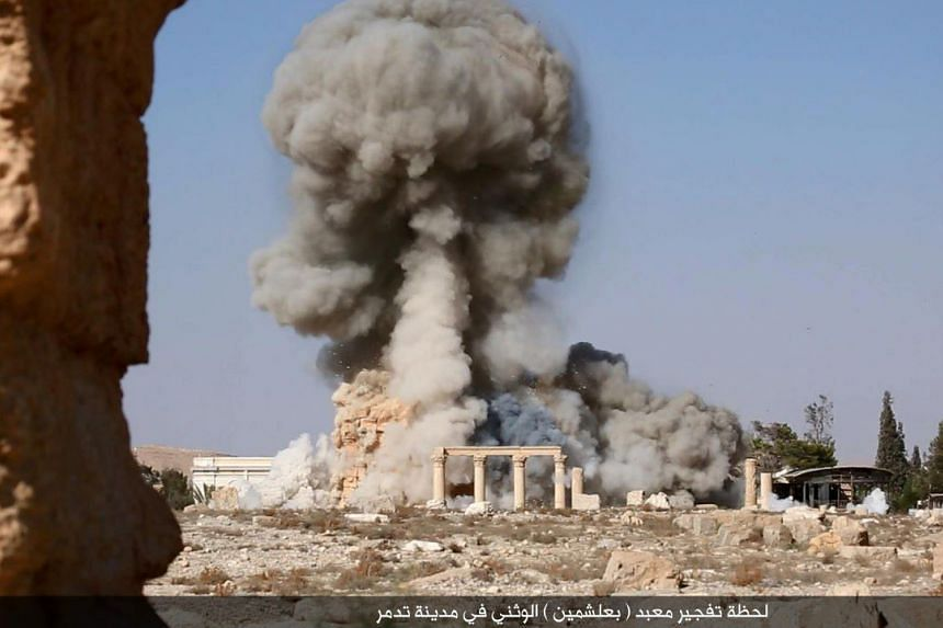 An undated image, which appears to be a screenshot from a video published by ISIS in the Homs province (Welayat Homs) on August 25, 2015, allegedly shows smoke billowing from the Baal Shamin temple in Syria's ancient city of Palmyra.