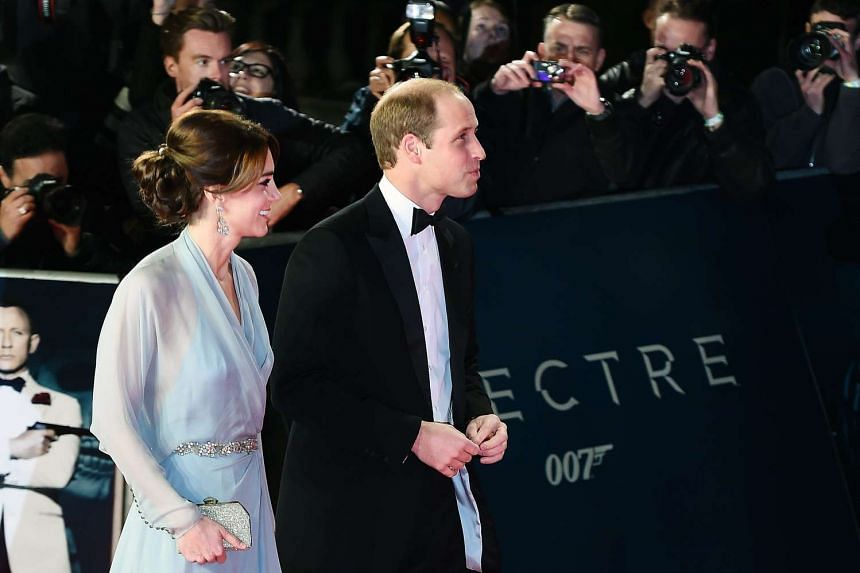 British Prince William, Duke of Cambridge (right) and Catherine, Duchess of Cambridge (left) arrive to attend the world premiere of the new James Bond film Spectre at the Royal Albert Hall in London on Monday.