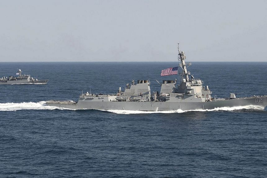 The USS Lassen (right) transits iduring an exercise in waters east of the Korean Peninsula in a March 12, 2015, handout photo provided by the US Navy.