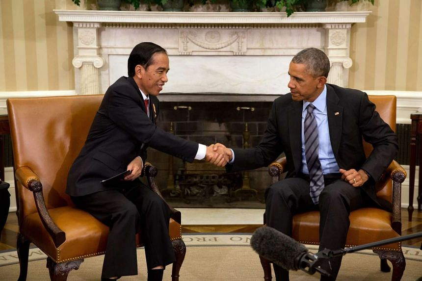 US President Barack Obama (right) meets with Indonesian President Joko Widodo of Indonesia in the Oval Office of the White House , in Washington, DC on Monday.
