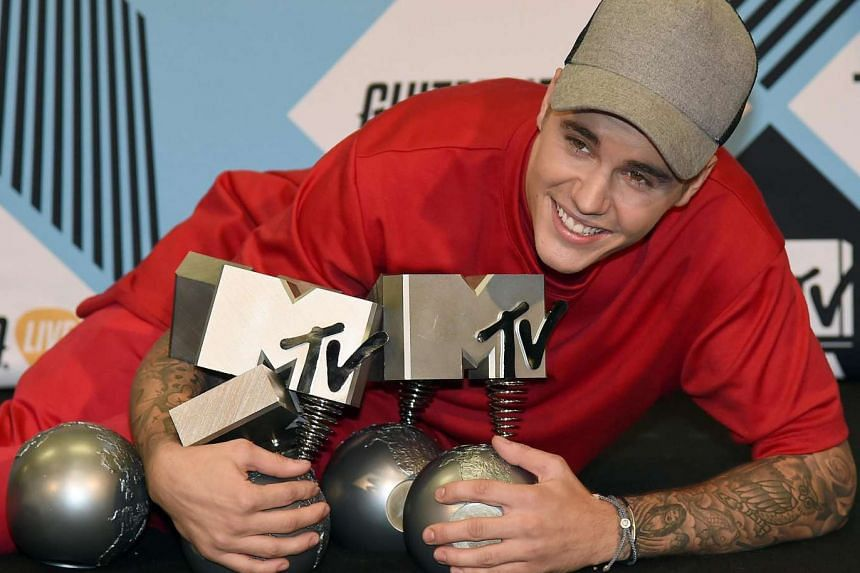 Justin Bieber with his awards haul.