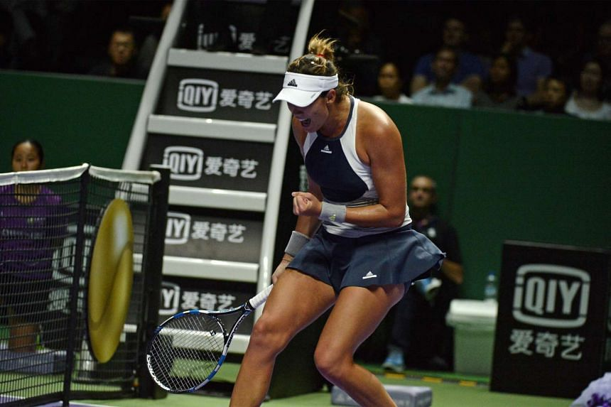 Garbine Muguruza of Spain celebrating during her match against Angelique Kerber of Germany during the singles round robin stage at the BNP Paribas WTA Finals in Singapore on Oct 28, 2015.