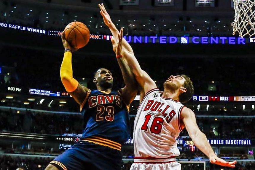 Chicago Bulls' forward Pau Gasol (right) reaching out to block a layup attempt by Cleveland Cavaliers' forward Lebron James at the United Centre in Chicago on Oct 27, 2015.