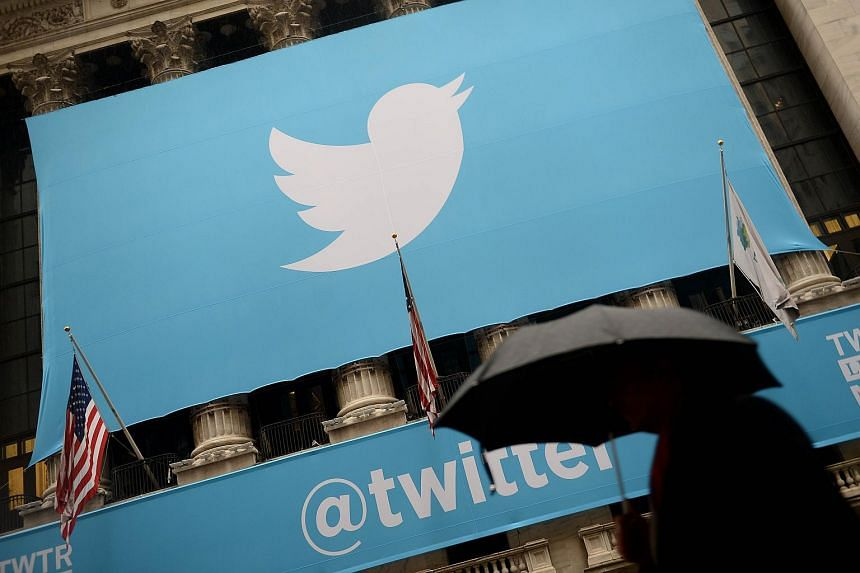 A banner with the logo of Twitter is set on the front of the New York Stock Exchange (NYSE)in New York.