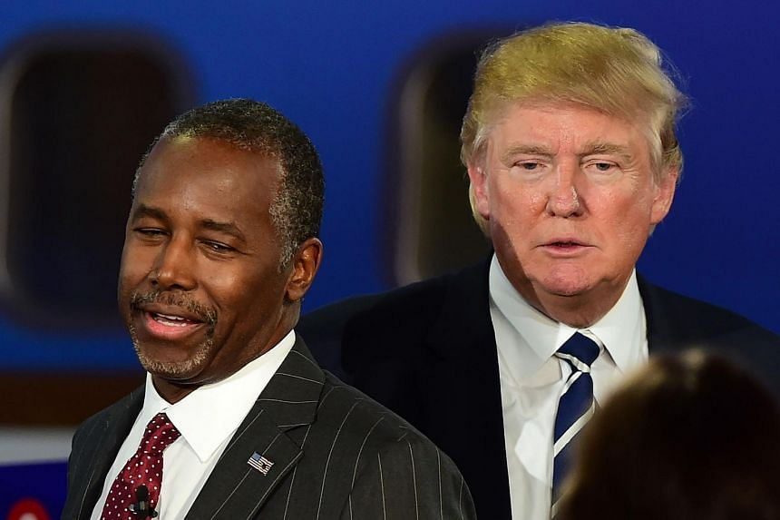 Republican presidential hopefuls Ben Carson (left) and Donald Trump participate in a debate at the Ronald Reagan Presidential Library in California on Sept 16, 2015.
