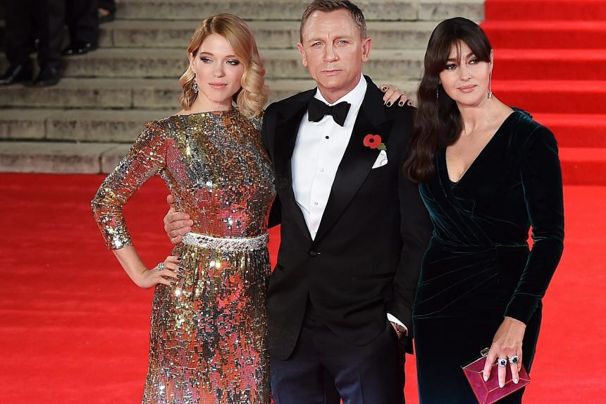 Britain's Prince William, his wife Kate and his brother Prince Harry were at the premiere of Spectre, which stars (from far left) Lea Seydoux, Daniel Craig and Monica Bellucci.