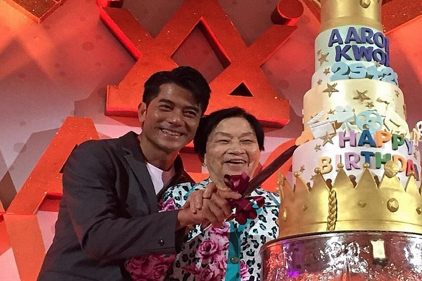 Singer Aaron Kwok with his mother at his surprise birthday celebration.