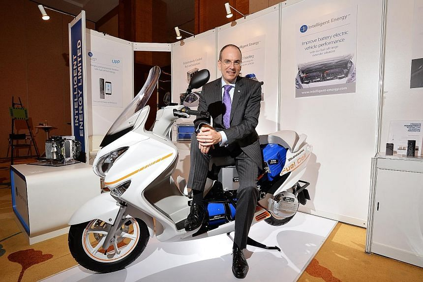 Mr Henri Winand, CEO of Intelligent Energy, sitting on a fuel cell-powered Suzuki scooter. The company will be collaborating with four major vehicle manufacturers to make fuel cell models. It has worked with Suzuki for the last decade.