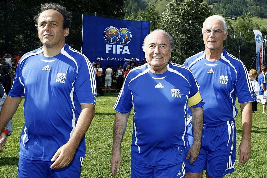 A file picture dated Aug 26, 2007 shows (from left) Uefa president Michel Platini, Fifa president Sepp Blatter and Franz Beckenbauer in happier times as they turn up for a gala match in the 10th edition of the Sepp Blatter Tournament in Ulrichen, Swi