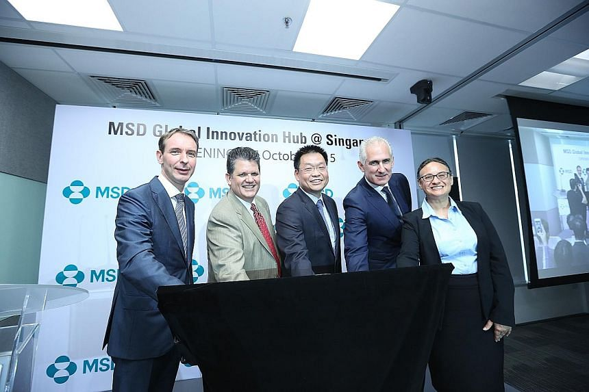 Mr Yeoh Keat Chuan (centre), managing director of the Economic Development Board, with (from left) Mr Jan Van Acker, president, Asia-Pacific, MSD; Mr Clark Golestani, executive vice-president and chief information officer; Mr Kevin Ali, president of