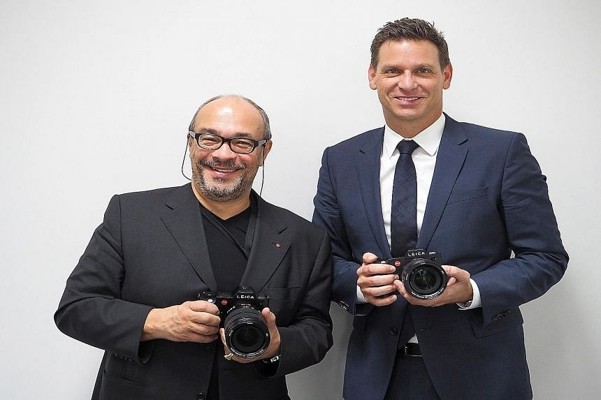 Leica chairman Andreas Kaufmann (left) and CEO Oliver Kaltner with the SL camera. It is targeted at professional photographers and serious amateurs. Leica's production line at Leitz Park in Wetzlar. The new SL series fills the gap between the M serie